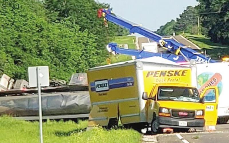 U-turn causes tanker to flip outside Teague