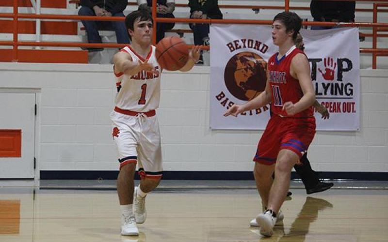 Teague guard Drew Satterwhite (1) passes the ball against Elkhart on Friday night. Photo by Skip Leon/For the Teague Chronicle
