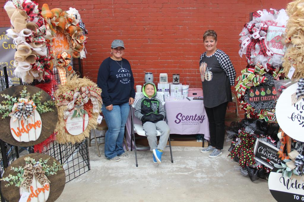 Emily Goodson, Lincoln Hart, and Anita Robinson are all smiles at the Teague Farmers Market. Goodson sells Scentsy and Robinson owns NeeNee's Stuff.