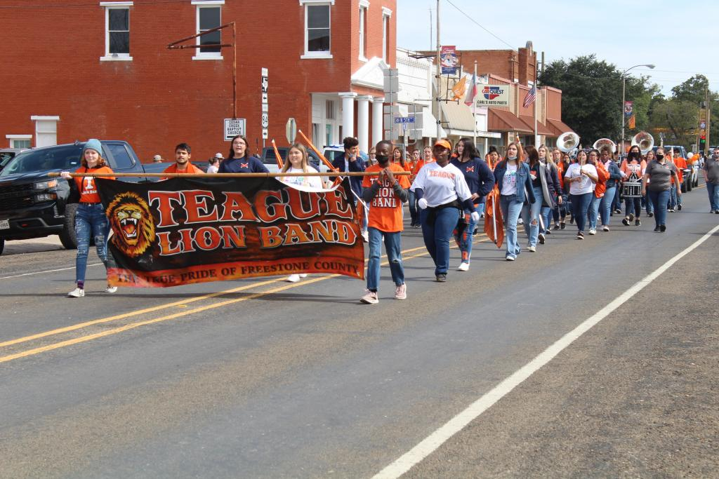 The Teague Lion Band leads the Homecoming parade on Saturday.