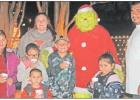 BELOW: The Morales family doesn't let the Grinch concern them at all. They had a good time at the Teague Hotel on Saturday night, Dec. 7. Photo Richard Nelson/ Teague Chronicle
